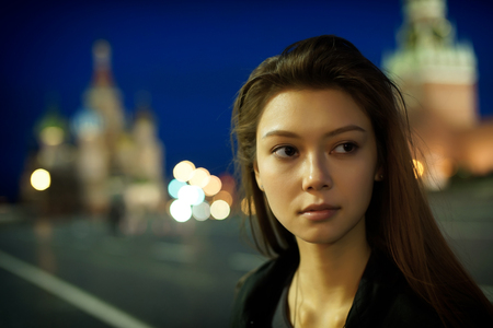 Night portrait of the young girl. photo