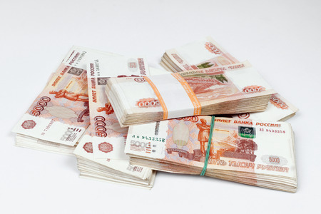 http://us.123rf.com/450wm/ratru/ratru1411/ratru141100004/33630018-packs-of-ruble-notes-randomly-lie-on-a-white-background.jpg