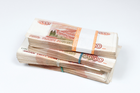 http://us.123rf.com/450wm/ratru/ratru1411/ratru141100005/33630037-packs-of-ruble-notes-piled-on-a-white-background.jpg