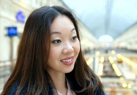 korean girl: Beautiful Korean girl smiles shyly.