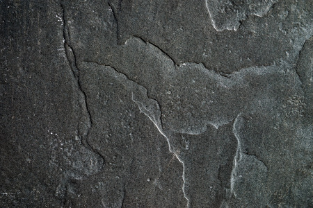 black stone: Stone wall with paint almost black, with traces of old age. Stock Photo