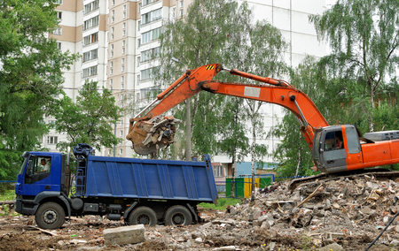 Demolition of an old apartment house. Cleaning of construction debris.
