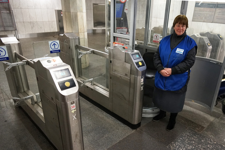 MOSCOW, RUSSIA - April 01, 2018: Employee of the metro at the turnstiles.. The functioning of the subway in Moscow.