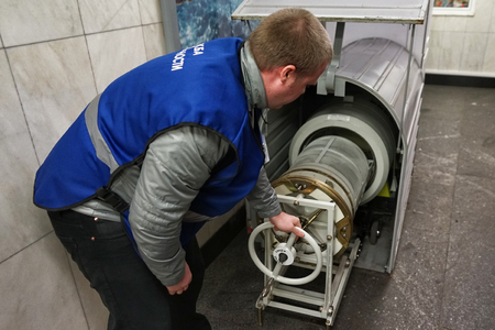MOSCOW, RUSSIA - April 01, 2018: The metro security officer checks the baggage for radioactive safety. The functioning of the subway in Moscow.