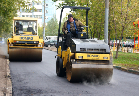 MOSCOW, RUSSIA - MAY , 2011:Two yellow rink for asphalt. The program of renovation of public areas in Moscow.