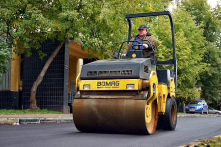 MOSCOW, RUSSIA - MAY , 2011: Laying of asphalt covering with a roller. The program of renovation of public areas in Moscow. Editorial