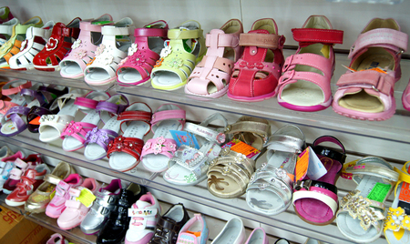 MOSCOW, RUSSIA - SEPTEMBER , 2011: Showcase with womens shoes and childrens sandals. Shoe store in Moscow.