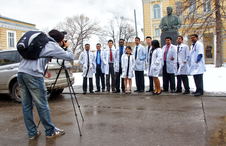MOSCOW, RUSSIA - APRIL , 2012: Young doctors graduates are photographed next to medetsinskim University in Moscow.