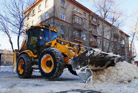 MOSCOW, RUSSIA - January , 2015: Bulldozer, remove the snow. Cleaning the streets of the city in winter in Moscow. Publikacyjne