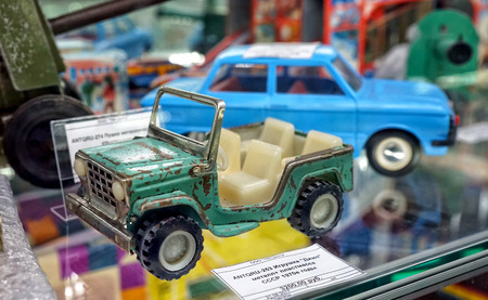 MOSCOW - MARCH, 2018: Metal jeep. Showcase with old toys in a retro toy store.