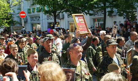 SEVASTOPOL, RUSSIA: - MAY 9, 2015: People at the demonstration on Victory parade. The celebration of 70 anniversary of Victory in the Great Patriotic War. Editorial