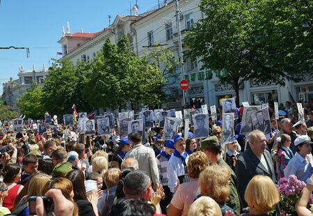 SEVASTOPOL, RUSSIA: - MAY 9, 2015: March Immortal regiment  on Victory parade. The celebration of 70 anniversary of Victory in the Great Patriotic War.