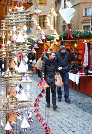 Warsaw - September 2013: New Year's fair in the city, a chalet with goods, people walking.