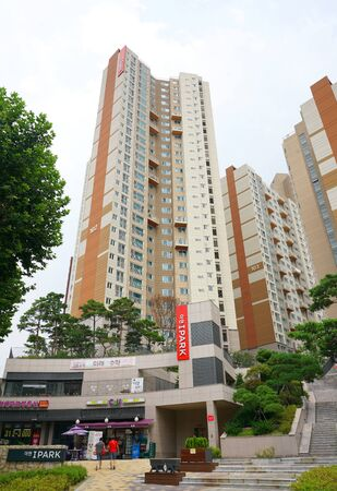 Seoul, Republic of Korea - August 2019: Residential development with infrastructure and shops in the center of Seoul. Landscaping of the outer space of the house territory.