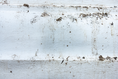 nuisance: White walls are stained with Bird feces Stock Photo