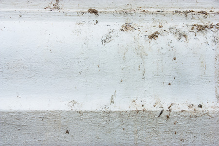 feces: White walls are stained with Bird feces Stock Photo