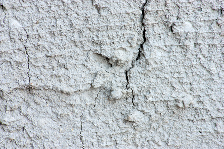 Close-up of a cement wall surface is not smooth. photo