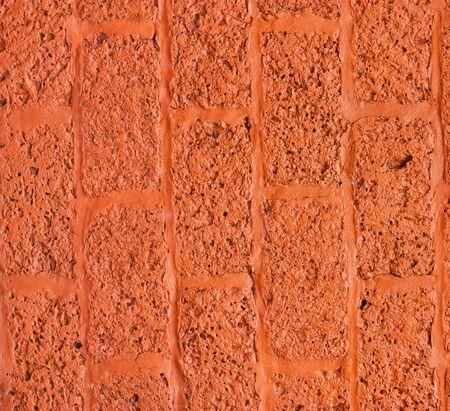 Close up of the wall surface blocks orange. photo