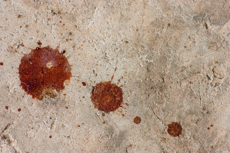 blood flow: Cement floor with a drop of blood.Background Stock Photo