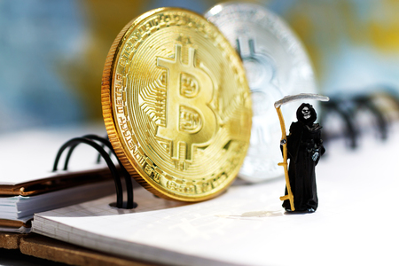 Miniature: Demon of death standing with bitcoin. Financial and business concept.