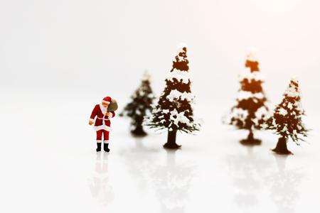 Miniature people: Santa Claus whit Christmas Tree.  Stock fotó
