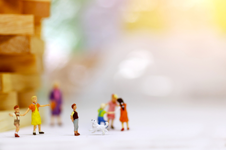 Miniature people, children and family enjoy with dog , happy family day concept.