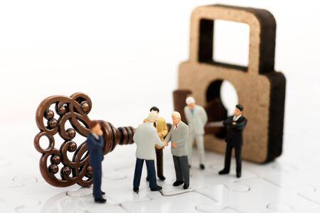 Miniature businessman handshake with unlock the keys, agreement, investment, partnership and business concept Reklamní fotografie - 132431727