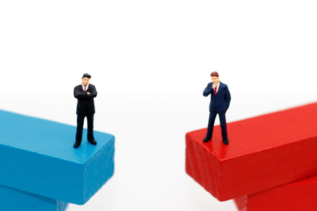 miniature business people standing on wooden box. Thinking, Target business concept. Stock Photo