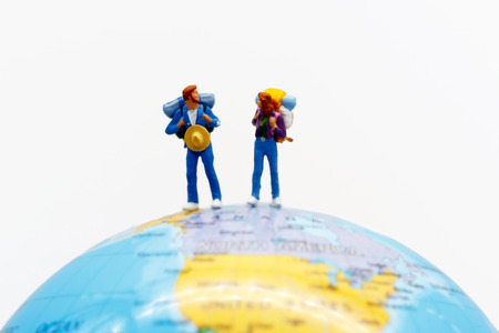 Miniature people, backpackers on the globe walking to destination. travel and business concept.