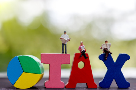 Tax concept, Miniature people reading with word