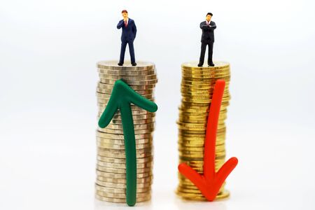 Miniature people:  Businessmen standing with coins stack, Finance, investment and growth in business concept. Reklamní fotografie - 132431729