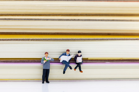 Miniature people: Business team reading book, education or business concept. Stok Fotoğraf