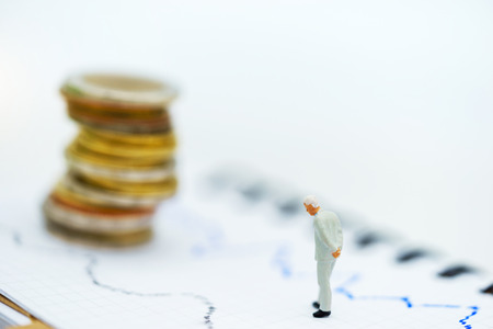 Miniature people:  Businessmen standing with coins stack, Finance, investment and growth in business concept.
