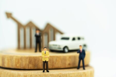 Miniature people:  Businessmen standing on coins stack with graph, Finance, investment and growth in business concept. Reklamní fotografie