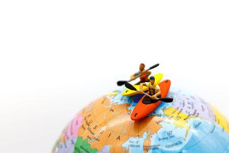 Miniature people on board of sea canoe. Summer concept. Reklamní fotografie