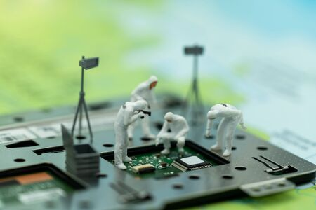 Miniature people searching for bugs on microchip. Vulnerability search and security system concept.