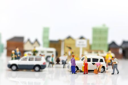 Miniature people: Tourists and shoppers in the city. Reklamní fotografie