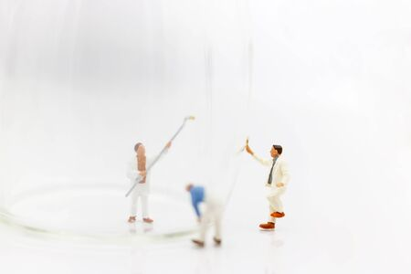 Miniature people: workers with paint colors for restoration and repair.