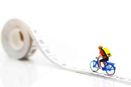 Miniature people enjoy riding a bicycle. Cycling for health Concept. Reklamní fotografie - 132603157