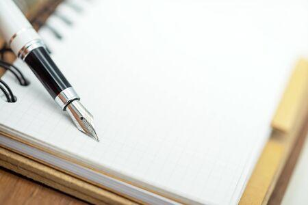 Close up fountain pen on paper  on a white background. Reklamní fotografie - 132636138