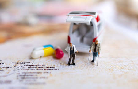 Miniature people : Doctor and patient standing with Capsule and Ambulance. Healthcare and medical concepts. Reklamní fotografie