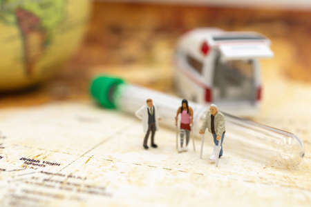 Miniature people : Doctor and patient standing with Capsule and Ambulance. Healthcare and medical concepts. Stock Photo