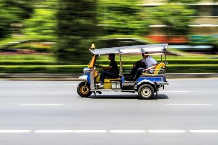 tuktuk: Tuk-Tuk in motion blur,Thailand three wheels taxi