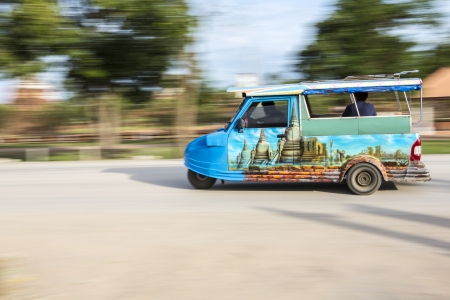 tuktuk: Tuk-Tuk in motion blur at Ayutthaya,Thailand three wheels taxi Stock Photo