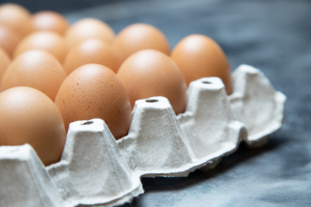 whole eggs in box. Chicken egg on the table. Stock Photo