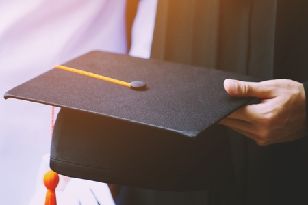 graduation,Student hold hats in hand during commencement success graduates of the university,Concept education congratulation.Graduation Ceremony,Congratulated the graduates in University. Stock fotó