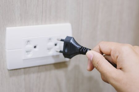Close Up the electrical power socket and plug socket on wall.