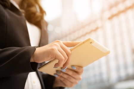 Business woman with hand on Computer Tablet in isolated a white background or Product Presenter