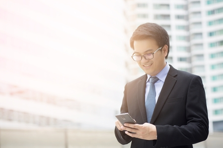 close up of Young Man using phone. or Business man Contact Customer