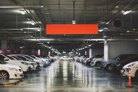 Concept sheet label write text.Cars parked in the parking lot.Open space area indoors. Stock Photo